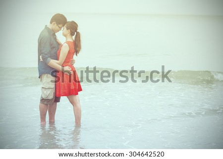 lovely couple people lifestyle romance at the beach.