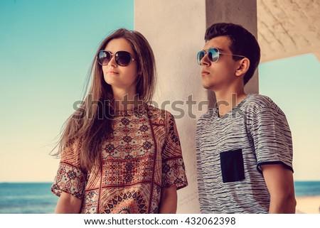 Lovely couple posing over blue sky on background. - stock photo
