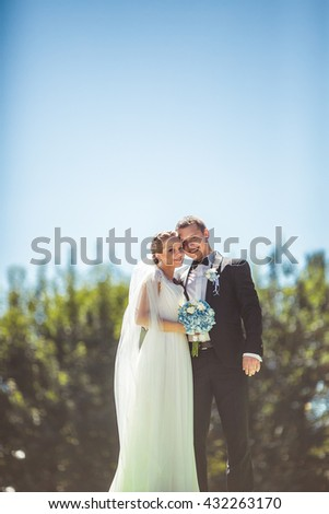 lovely couple standing on a background of blue sky