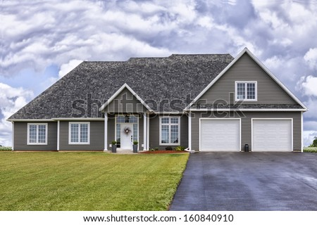 Lovely detached home in a rural setting. - stock photo