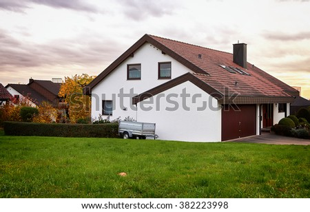 Lovely detached house in a rural site. Modern german house. - stock photo