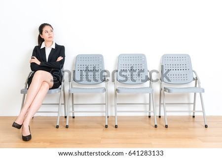 lovely elegant business girl waiting interview stock photo
