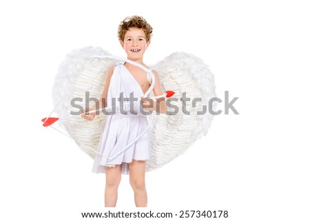 Lovely emotional little boy in a costume of angel. Cupid with a bow and arrows of love. Valentine's day. Isolated over white. - stock photo
