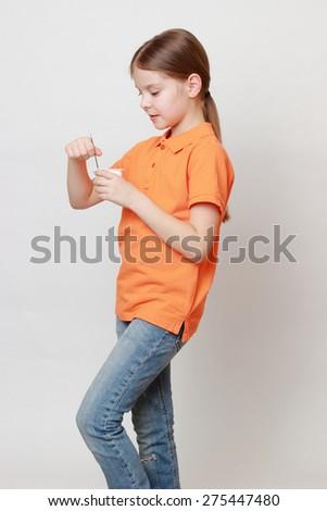 Lovely european little girl eating yoghurt - stock photo