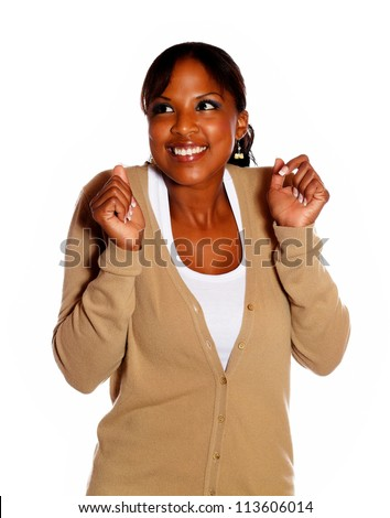 Lovely excited young woman with hands up against white background - stock photo