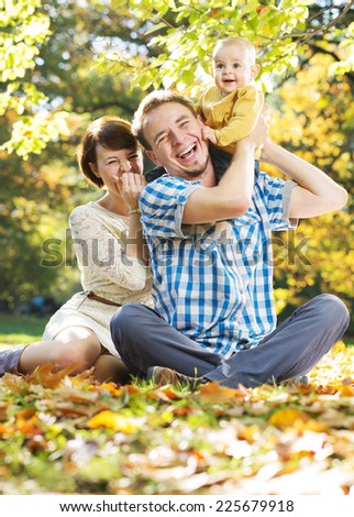 Lovely family enjoying weekend in the park - stock photo