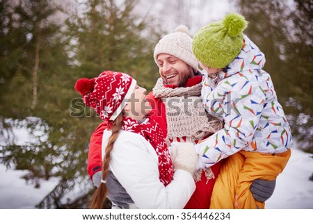 Lovely family having fun together outdoors - stock photo