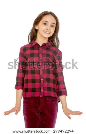 Lovely fashion small girl Oriental appearance with long dark hair on her head , the girl dressed in a plaid shirt and corduroy jeans, close-up-Isolated on white background - stock photo