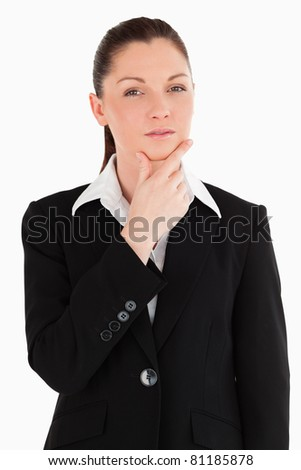 Lovely female in suit posing while standing against a white background - stock photo