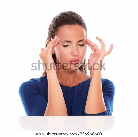 Lovely female with closed eyes suffering headache in white background - stock photo