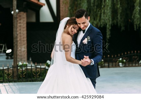 Lovely first dance of the married couple - stock photo