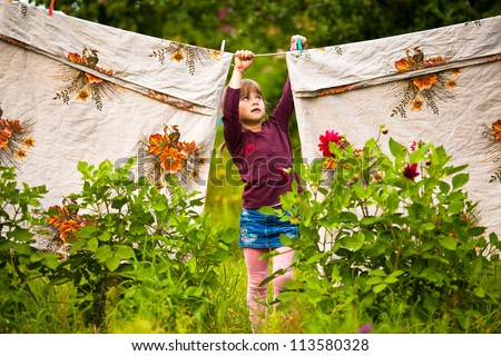 Lovely five-year girl with clothespin outdoor - stock photo