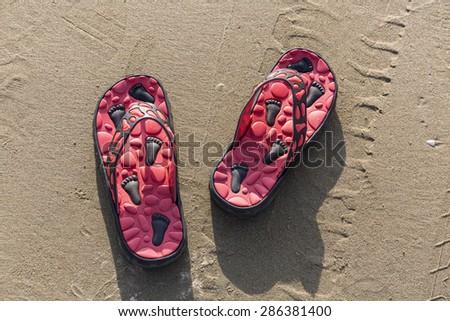 Lovely flip flops in sands on Thailand beach  - stock photo