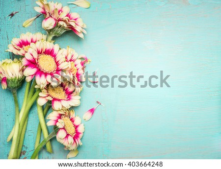 Lovely flowers on turquoise shabby chic background. Festive greeting card
