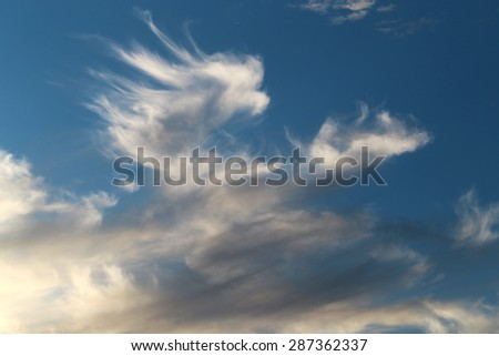 lovely fluffy clouds in the sunset on a summer evening