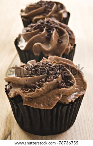 Lovely fresh chocolate cupcakes - very shallow depth of field - stock photo