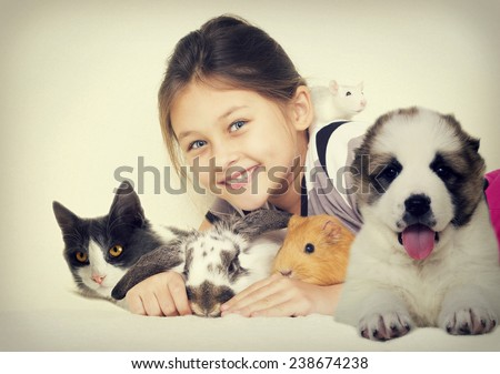 lovely girl and a group of pets - stock photo