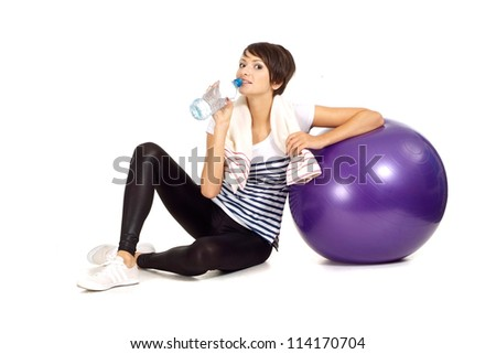 Lovely girl at the gym on a white background - stock photo