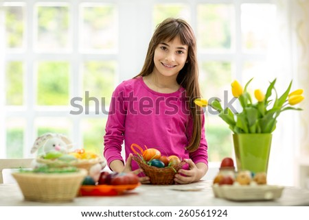 lovely  girl holding  basket of Easter eggs - stock photo