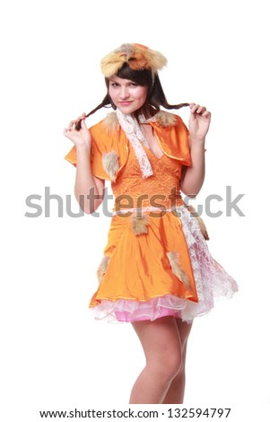 Lovely girl in an orange dress and hat