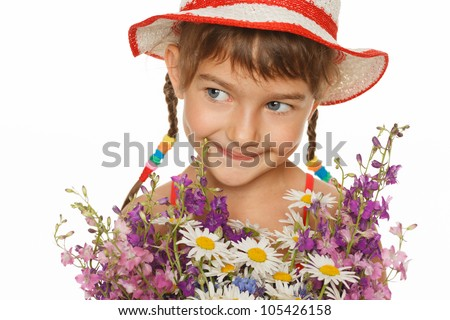 Lovely girl in summer hat holding a bunch of field flowers looking away, over white background - stock photo