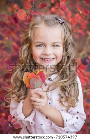 Lovely girl in the autumn forest on a walk