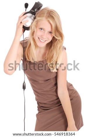 Lovely girl listening a music with headphones, white background