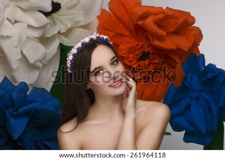Lovely girl with a beautiful wreath in the head - stock photo