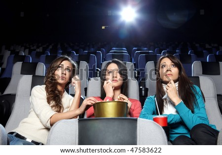Lovely girls cry at viewing at cinema - stock photo
