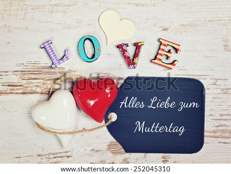lovely greeting card - german for happy mothers day - stock photo