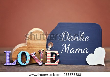 lovely greeting card - german for thank you mom - stock photo