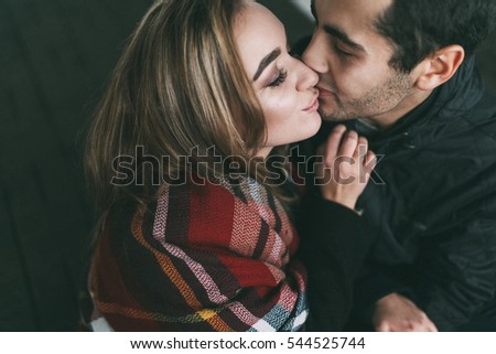 Lovely happy couple have fun.romantic photo.Hugs together on the parking place