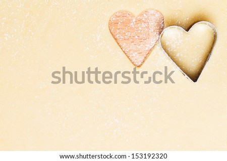 lovely hearts cutted out of dough from top with copy space - stock photo