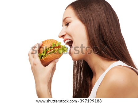 Lovely hungry woman eating a burger