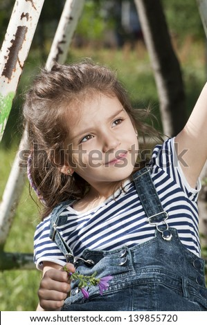 Lovely kid playing in park - stock photo