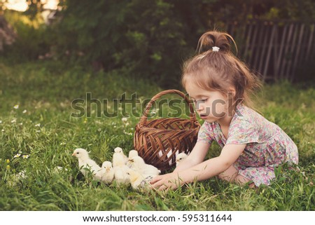 lovely kid with tiny chicken