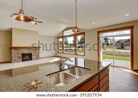 Lovely kitchen with bar island, and hardwood floor.