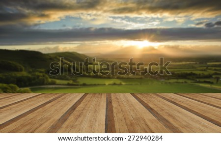 Lovely landscape of countryside hills and valleys with wooden planks floor - stock photo