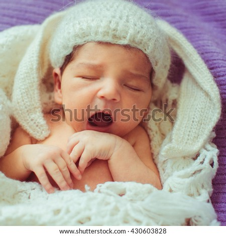 lovely little amazing baby lying in a white scarf - stock photo