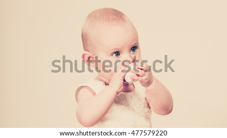 Lovely little child girl. Portrait of cute beauty sweet baby. Face emotion expression.