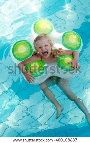 lovely little child laughing in the swimming pool