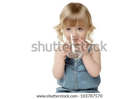 Lovely little girl drinking water, over white - stock photo