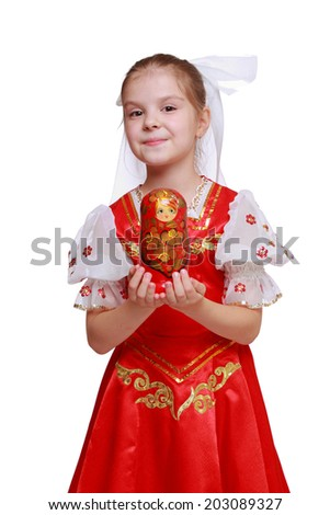 lovely little girl holding wooden doll in tradition style Hohloma