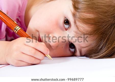 Lovely little girl learning to write