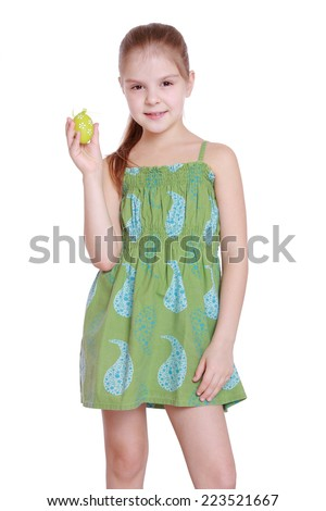 Lovely little girl with green Easter egg isolated over white background