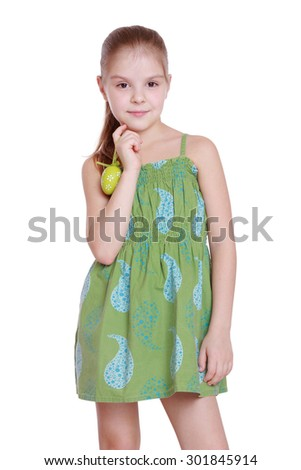 Lovely little girl with green Easter egg isolated over white background - stock photo