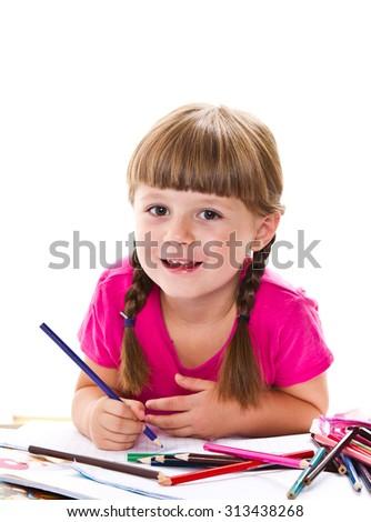 lovely little girl writing at the desk - stock photo