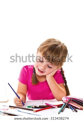 lovely little girl writing at the desk