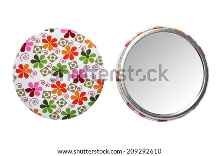 Lovely little pocket mirror textured with small flowers. Studio photography of accessories for girls - isolated on white background  - stock photo