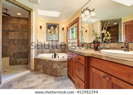 Lovely master bathroom with stone floor and large shower.House interior. - stock photo